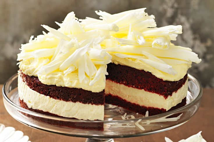 Red velvet cake and cheesecake combine to create one beautiful dessert showpiece.
