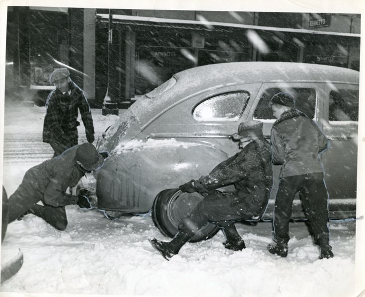 Pushing a car stuck in the snow, Wisconsin Rapids, ca. 1950. Photo by Don Krohn. From South Wood County Historical Corporation.