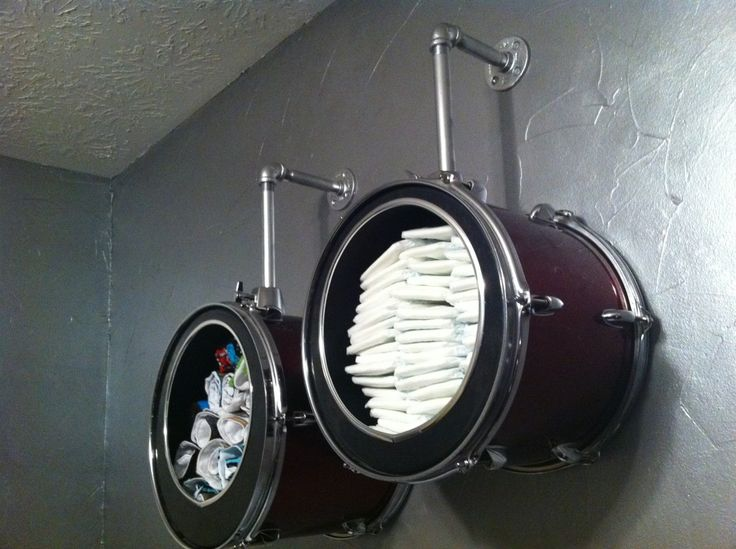 Using drums on wall to hold diapers and blankets in rock and roll themed nursery :0)  Awesome!
