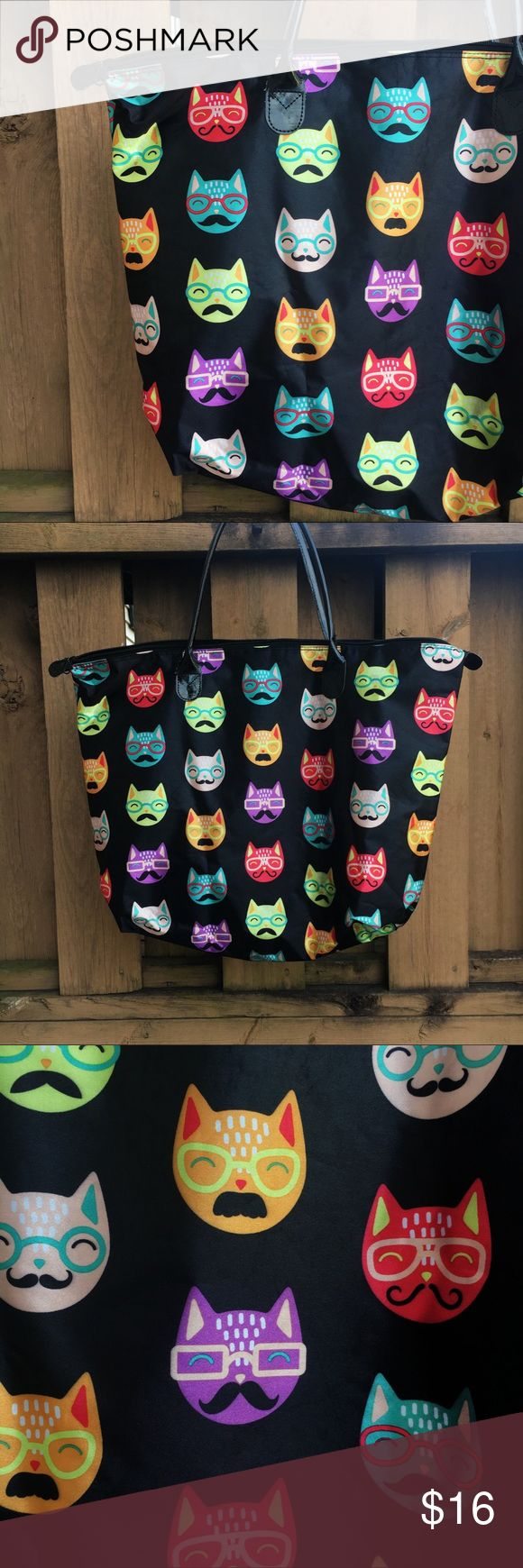 """Funky Cat Tote 😻 Show off your groovy style and have plenty of room for your belongings with this funky cat shoulder tote. Perfect size for a laptop bag, overnight bag, or school bag.   The strap is 8"""" from top to the zipper and has some wear and tear shown in the last photo, but still in good condition.   Open to most offers and I provide same day shipping on most orders! Bags Totes"""