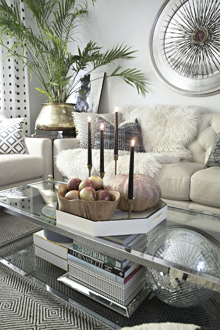 a hint of modern fall decor in this eclectic home tour: cream leather sofa with chrome 2-tier coffee table, disco ball and black and white accents