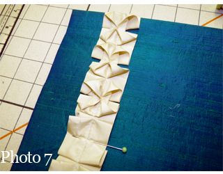 Origami fabric ruffle tutorial- I`d love to see this on a curtain panel treatment.