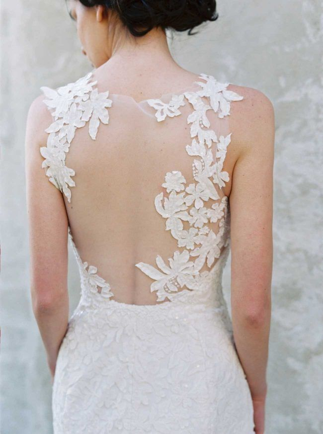 This sheer, open backed gown has beautiful, asymmetrical floral lace detailing. Gown from Sareh Nouri's 2017 Wedding Dress Collection
