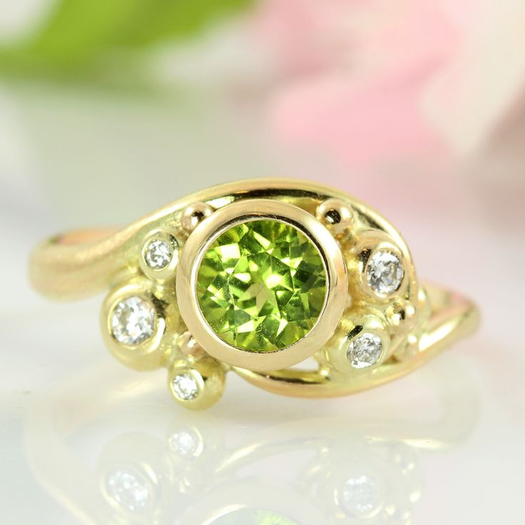 Fairytale gold ring with peridot and diamonds. One of a kind. A juicy green facet cut peridot set in warm 14k gold and surrounded by a total of 0,12 ct diamonds. This ring is a cheerful showstopper with its glittering green and white gems – perfect as an engagement ring, fit for fey or for a very special person – you!