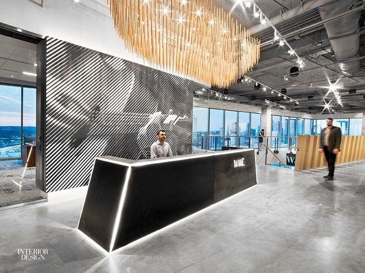 LEDs shine through die-cut apertures in the blackened-steel reception deskat the Nashville office of WME byHastings Architecture Associates. Photography by Eric Laig...