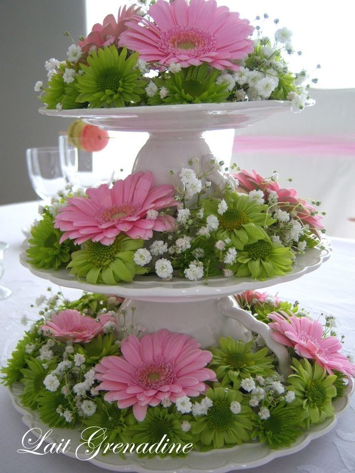 Use a tiered serving piece and fill it with short flowers.