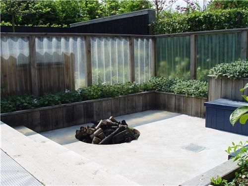 This Firepit Is Protected From The Wind By A Wood Wind Screen Featuring  Translucent Fiberglass Panels.