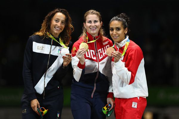 (L-R) Silver medalist Elisa di Francisca of Italy, gold medalist Inna Deriglazova of Russia and bronze medalist Ines Boubakri of Tunisia pose on the podium during the medal ceremony for the women's individual foil on Day 5 of the Rio 2016 Olympic Games at Carioca Arena 3 on August 10, 2016 in Rio de Janeiro, Brazil.