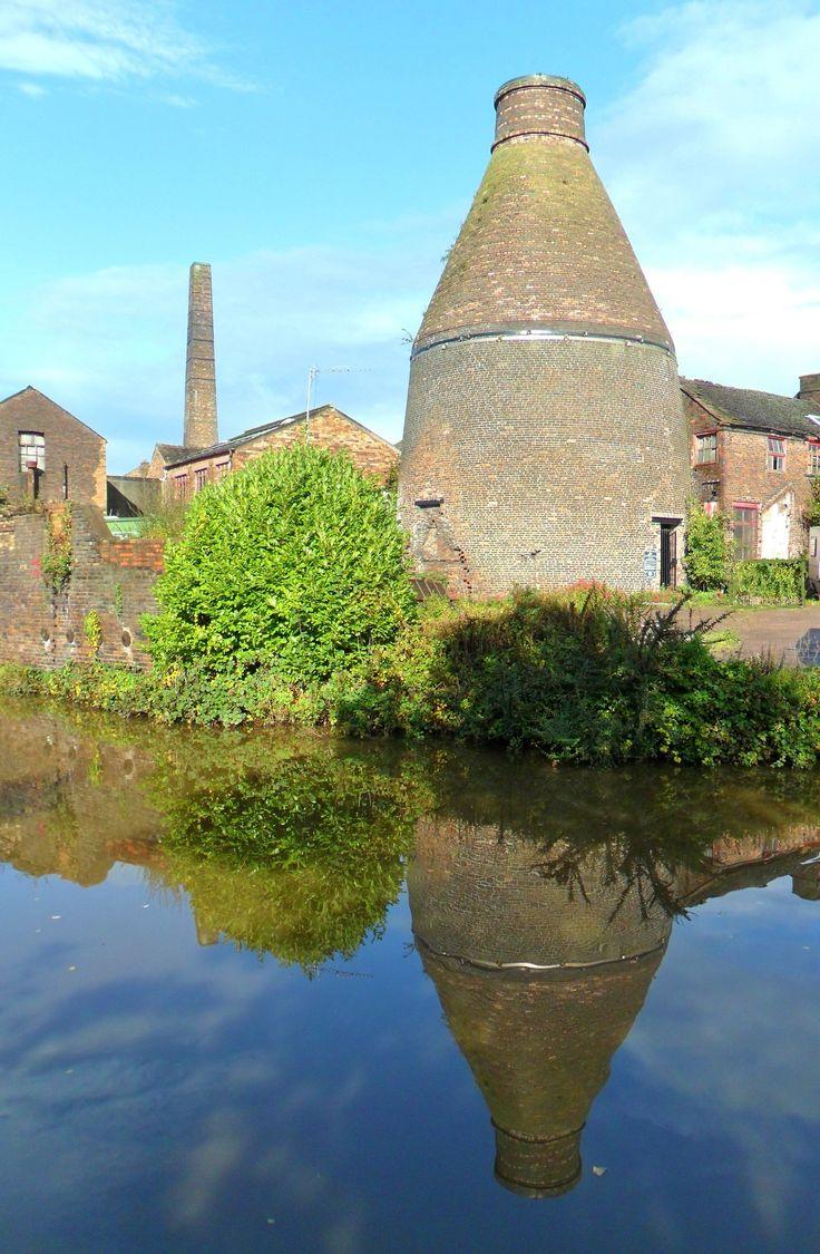 Brick Kiln, reflected in canal, Burslem, Stoke on Trent, Staffordshire