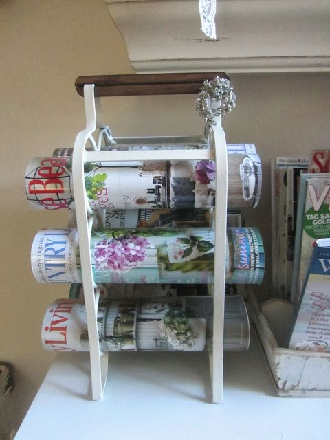 Use a wine rack for magazines - great idea - except mine are full of wine. From Junk Chic Cottage
