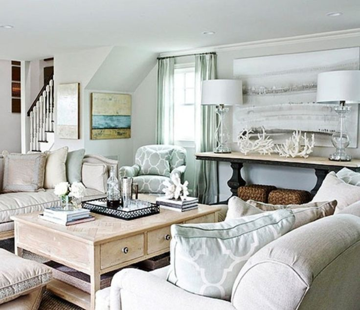 Throw pillows are another way to introduce color.    Image result for Minimalist coastal grey decor