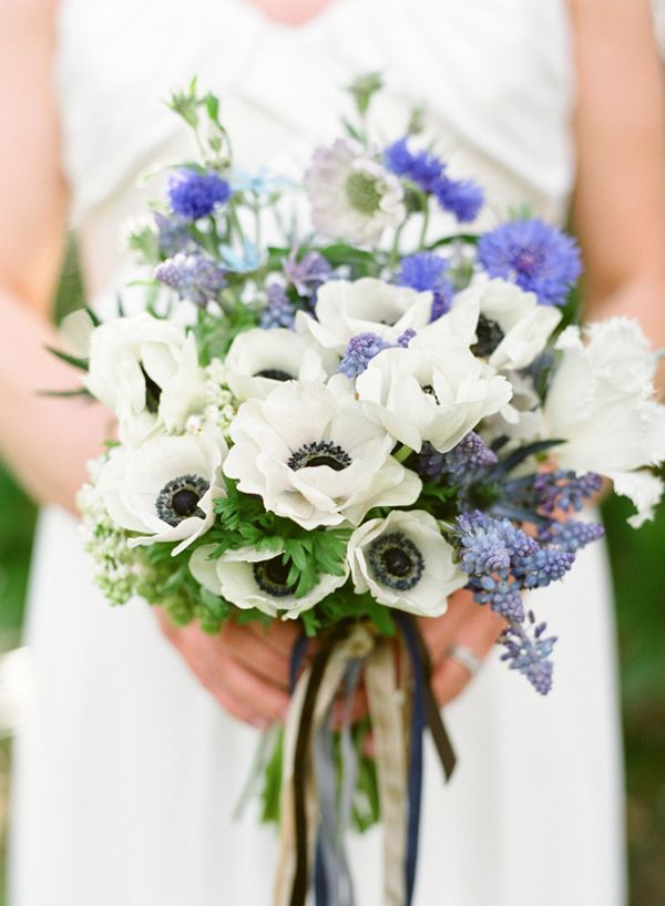... the flowers ... the reason this bouquet is so beautiful is the blue flowers. There are not many naturally occurring blue flowers - here are some good choices: tweedia, muscari, light & dark blue delphinium, bachelor buttons/cornflower, nigella & thistle.