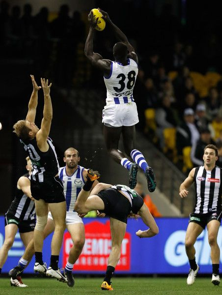 Majak Daw of the Kangaroos takes a spectacular mark over Jonathon Marsh of the Magpies during the 2016 AFL Round 18 match between the Collingwood Magpies and the North Melbourne Kangaroos at Etihad Stadium on July 22, 2016 in Melbourne, Australia.