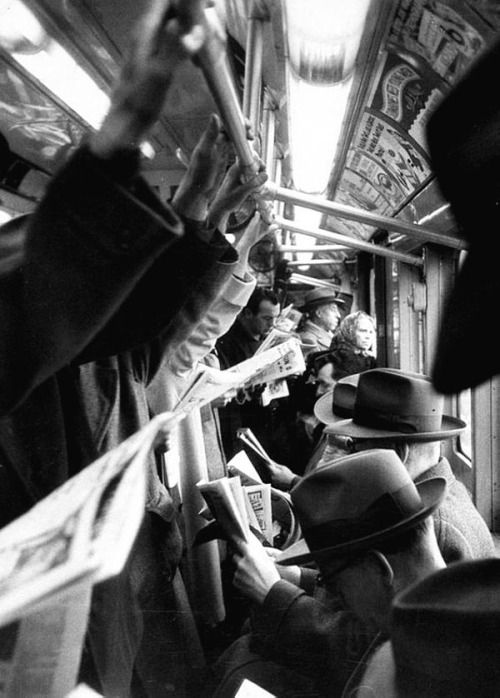 Rush hour on the Subway, New York, 1952, photo by Cornell Capa   RePinned by : www.powercouplelife.com
