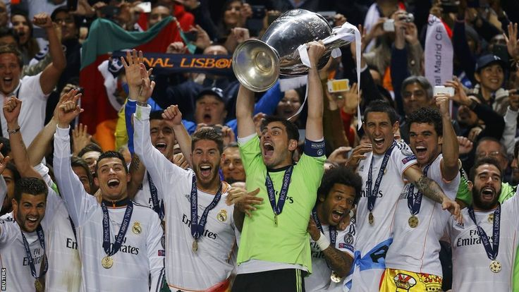 Iker Casillas lifts the Champions League trophy as Real Madrid win the competition for the 10th time