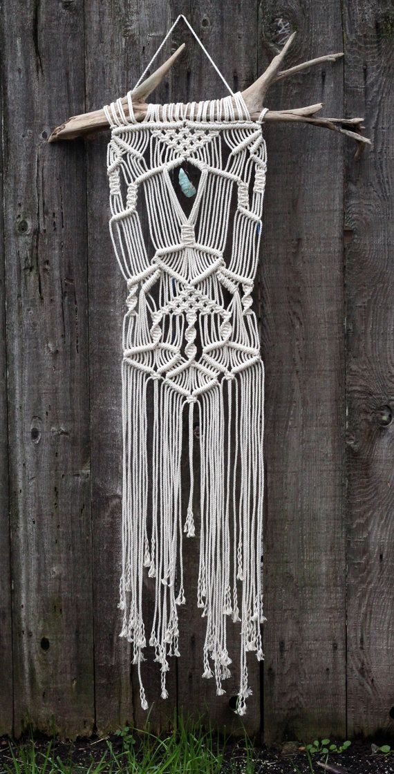 Large macramé wall hanging on drift wood with aquamarine fluorite crystal