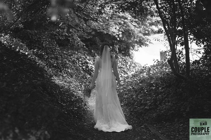 The bride taking a walk in the Iveagh gardens about to meet her groom for their first look. Wedding in The Abbey Tavern, Howth. Photographed by Couple Photography.