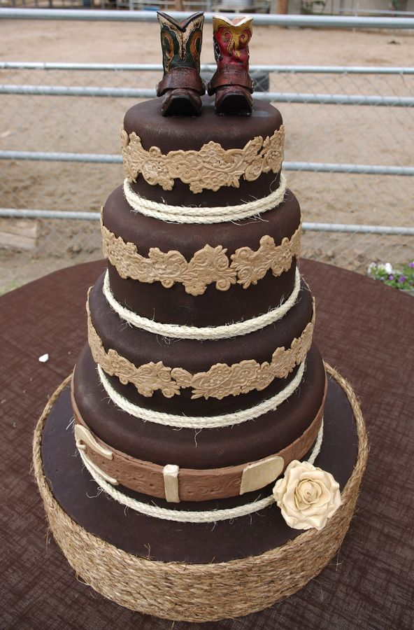 Check out thisnWestern Wedding Cake! #western #countrywedding #weddingcake For more Cute n' Country visit: www.cutencountry.com and www.facebook.com/cuteandcountry