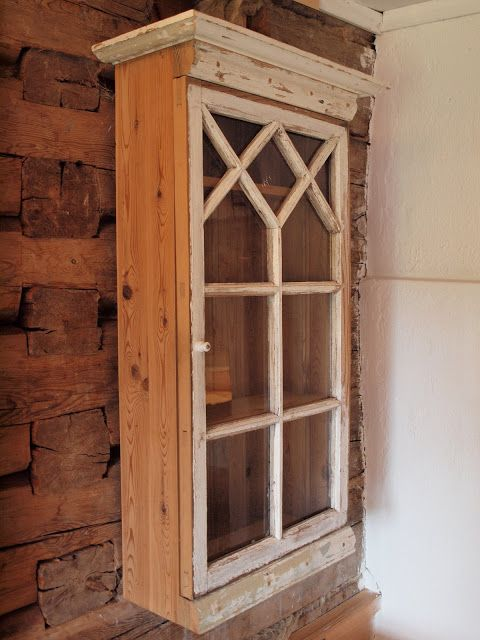 Old Window converted to a nice wooden cabinet. The grid patterns of older windows can really add to the uniqueness of a piece!