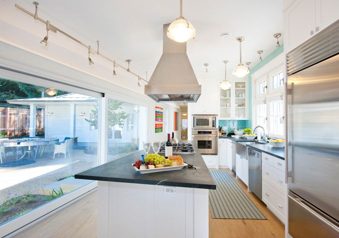 House of Turquoise: PassivWorks/Jann Blazona interior design. Love the turquoise, white cabs, schoolhouse lights, and open plan!
