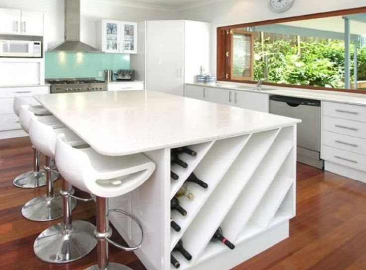 Entertainer's dream kitchen, white bench with wine storage, large window for serving food outdoors