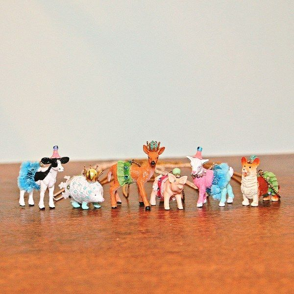 I bet my nieces would love to make these!  Anthro Inspired Party Animal Necklaces