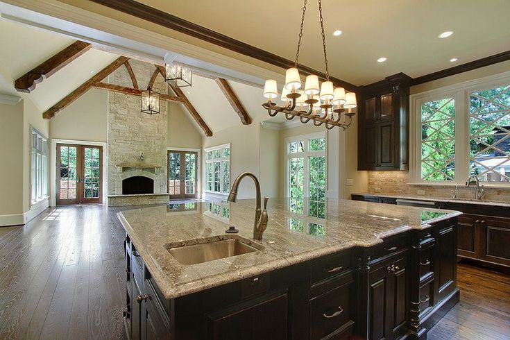 I love how the kitchen opens up into a grand eating area, can picture it now
