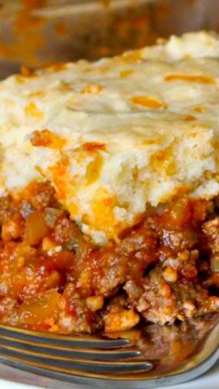 Sloppy Joe Casserole Recipe ~ It's an easy twist on traditional sloppy joes that's flavorful and delicious! The cheesy crust compliments the beefy tomato filling so well