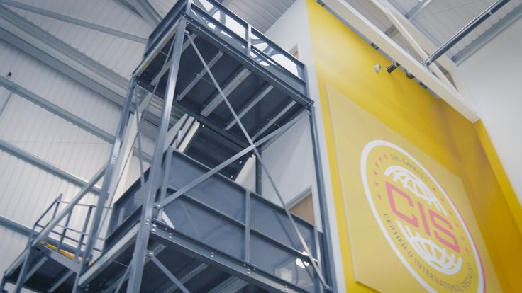 The elevated #mezzanine area allows the workers at DHL to connect, from those on the shop floor, to the administrators working within the office. This improves flows of communication as studies have shown.