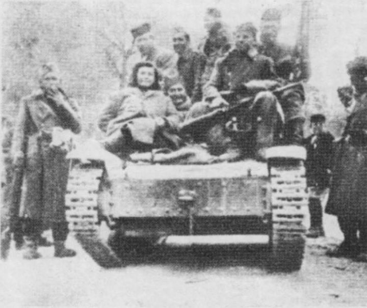 "Partisans of the Main Operational Group on the tank captured from the Italians in late February 1943.Battle of ""Neretva"""