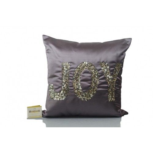 This #Soft Mauve #Color in silk fabric, features sequence work & back zip; comes with compress poly filler