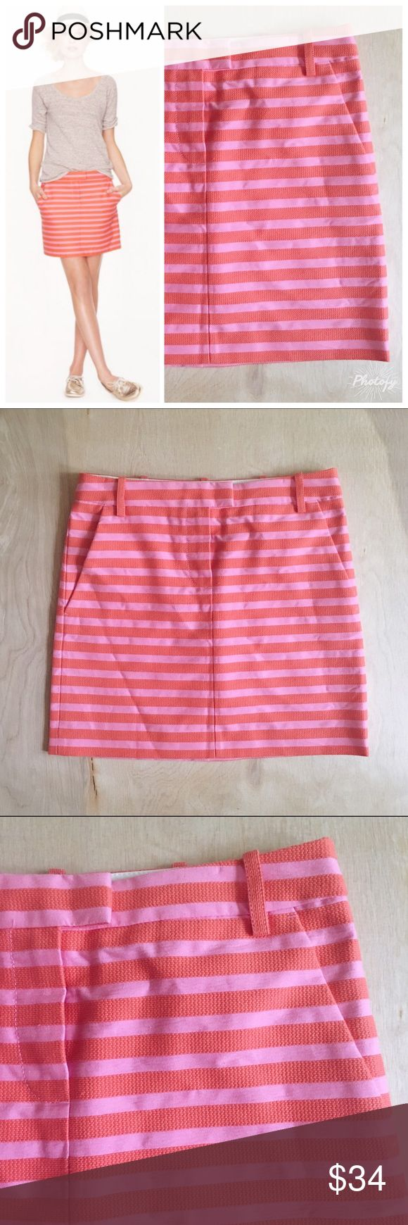 """J Crew Postcard Mini Skirt in Textured Stripe J. Crew (retail, not outlet) Postcard Mini Skirt in coral and pink textured stripe colorway. The coral stripes are actually embroidered onto the skirt. Trouser details such as belt loops and zip fly with tab closure. In excellent preowned condition. No stains, holes, or significant wear. Size 00. Sits at hip. Approximate measurements when laid flat: waist 14"""", hips 17.75"""", length 15.75"""". J. Crew Skirts Mini"""
