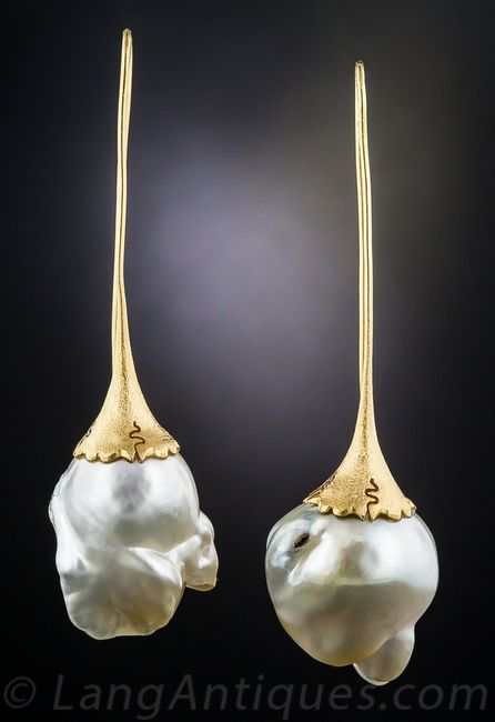 Modern Baroque Pearl Earrings by Fichot Dramatic and artsy, over 2 and 1/2 inches long, these dynamic earrings were presumably   and crafted, although not signed, by Jean Francois Fichot (we acquired it along with the matching ring # 30-3-7133). A shimmering pair of large, highly-baroque South Sea pearls, with orient resembling the iridescence of a bubble are capped in rich velvety 18K yellow gold, extruded to create long slender ear wires. Chic, moderne minimalism.
