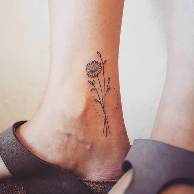 Minimalist Flower Bouquet Tattoo On The Right Ankle By Elsbeth Tattoo Flower Bouquet Tattoo Bouquet Tattoo Ankle Tattoo Designs