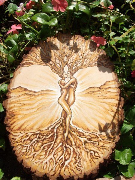 "I love this pyrography of two people enterwining in the tree of life :)  how cool would it be to have this customized with micah and I in it?  Perhaps as a wooden trunk for the wedding cake ""branches"" on top <3"
