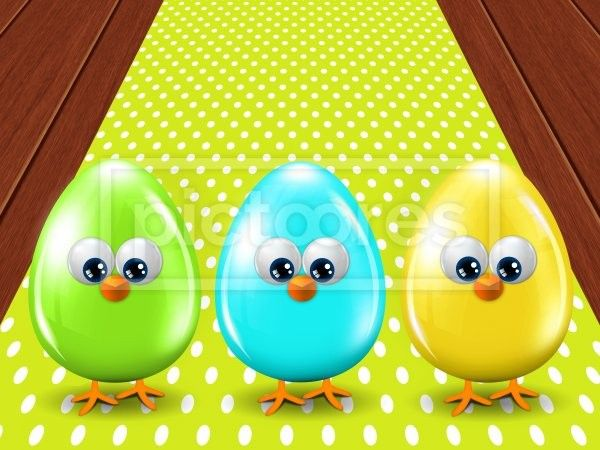 three colored Easter eggs standing on wooden floor