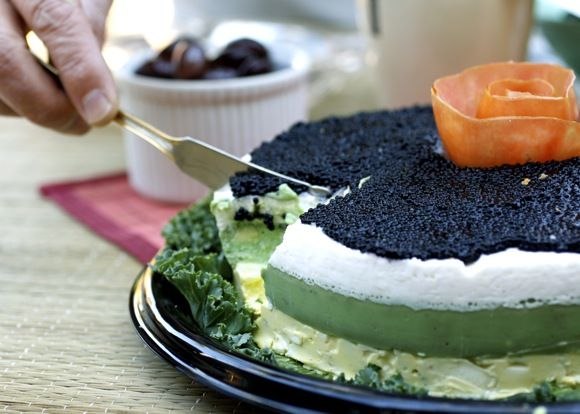Four-Layer Caviar Cake - Caviar tops a molded sour cream/cream cheese/shallot layer over a molded avocado/parsley/lemon layer. The base is creamy egg salad/mayonnaise/green onion, all decorated with a pretty tomato rosette. #holidayavocado @Amazing Avocado