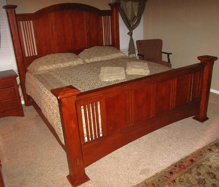 Found on EstateSales.NET: Star Furniture Cherry Wood King Size Bed Frame, King Size Blanket with Pillow Covers and King Size Mattress Set