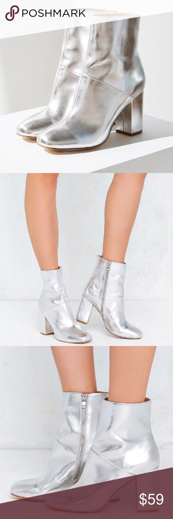 "Urban Outfitters Zelda Metallic Ankle Boot Brand new. Shine so bright you light up the room in these '60s-inspired metallic ankle boots. So mod, cut above ankle in a shiny vegan leather with inner ankle zipper closure. Finished with a sloping sole + covered block heel with rubber coating for perfect traction on the dance floor. Price is firm.   Content + Care - Polyurethane, rubber - Wipe clean  Size - Heel height: 3.5"" - Shaft height: 6"" Urban Outfitters Shoes Ankle Boots & Booties"