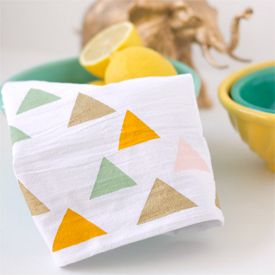 Contact paper and paint make for a pretty little stenciled tea towel.