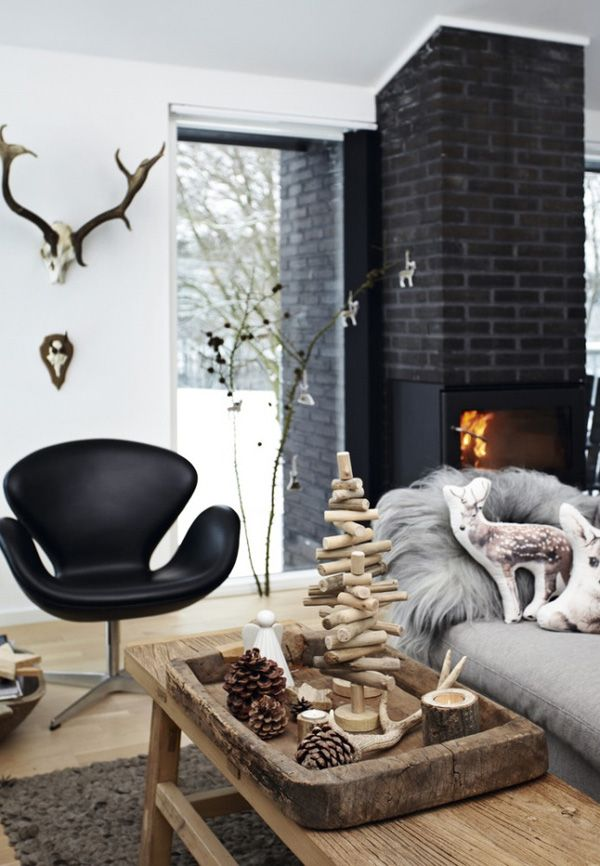 A stunning Danish Christmas cottage by creative director Betina Stampe of Bloomingville mixing lots of natural elements and textures with monochrome decor.