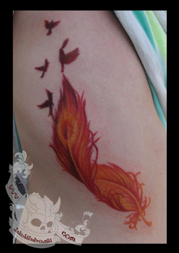 Red/orange phoenix feather tattoo... The colors are exquisite!