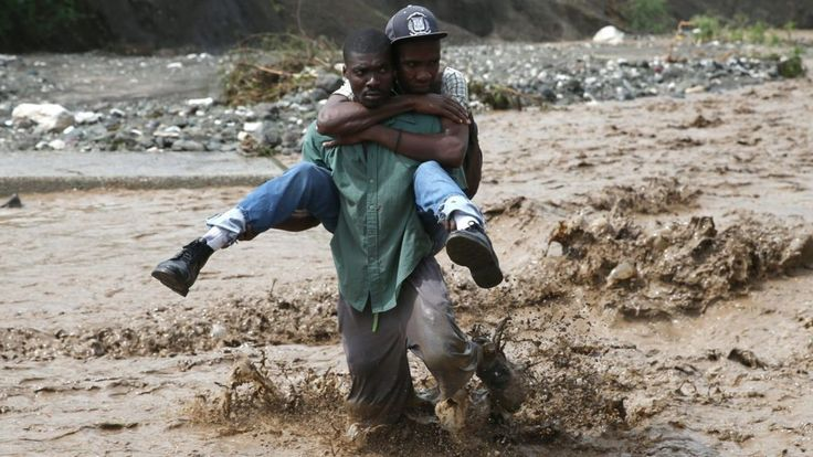 Rescue workers in Haiti struggle to reach parts of the country cut off by the most powerful Caribbean hurricane in nearly a decade.