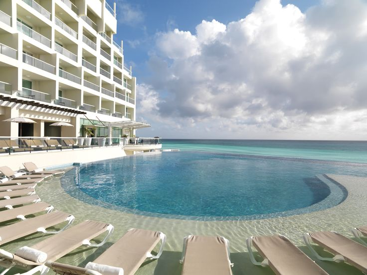 Pool or beach? Have the best of both worlds during your honeymoon at Sun Palace in Cancun. #CouplesOnly #AllInclusive #Travel #WeddingIdeas