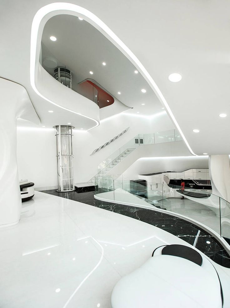 With a futuristic and retro look, the concept of this home is based on its melting and liquid appearance. Everything seems to melt, from the façade to the interior design, through curves and rounded furniture.