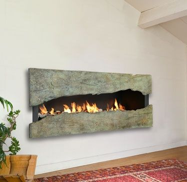Completely in love with this fireplace. The flames peaking through the large slabs of natural stone was a beautiful idea.