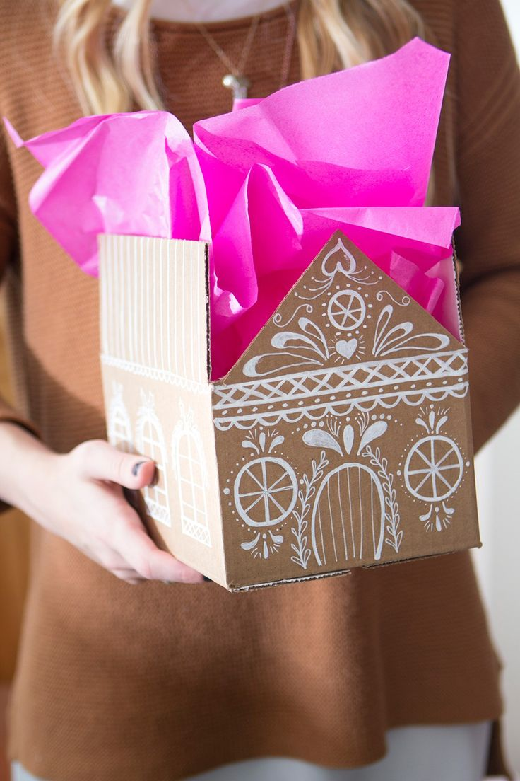 HOWTO // Create your own Gingerbread house gift box. Such a special and festive way to wrap your presents for Christmas. All it takes is a bit of cardboard and some white paint.