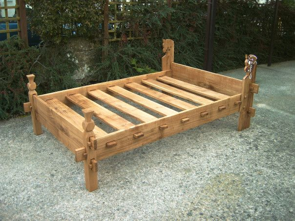This is an Oak replica of a Viking bed found on the 9th century viking ship at Gokstad in Norway.