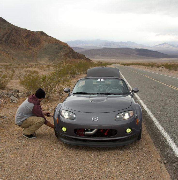Making a slight adjustment to tire pressures during a safety meeting. #mx5 #sema2016 #roadtrip