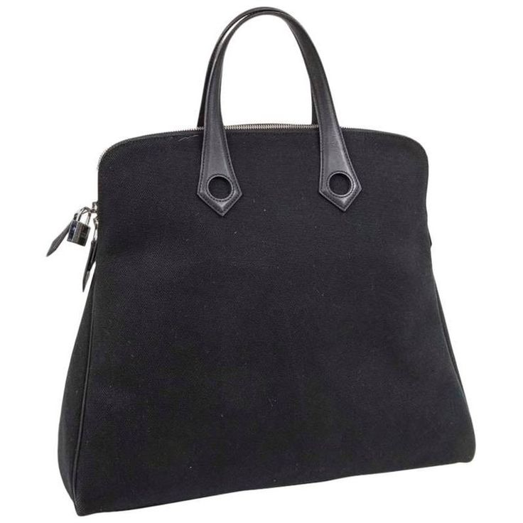 HERMES Bag in Black Canvas and Black Leather Handles | From a collection of rare vintage top handle bags at https://www.1stdibs.com/fashion/handbags-purses-bags/top-handle-bags/
